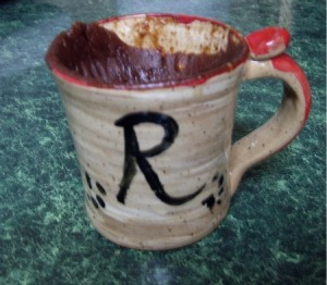 Sinking chocolate cake in a mug