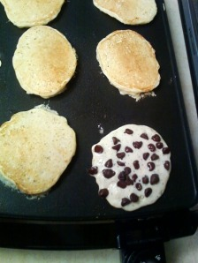 the golden brown of cooked pancakes and lots of chocolate chips